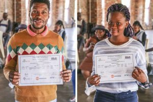 Graduates proudly presenting their certificates